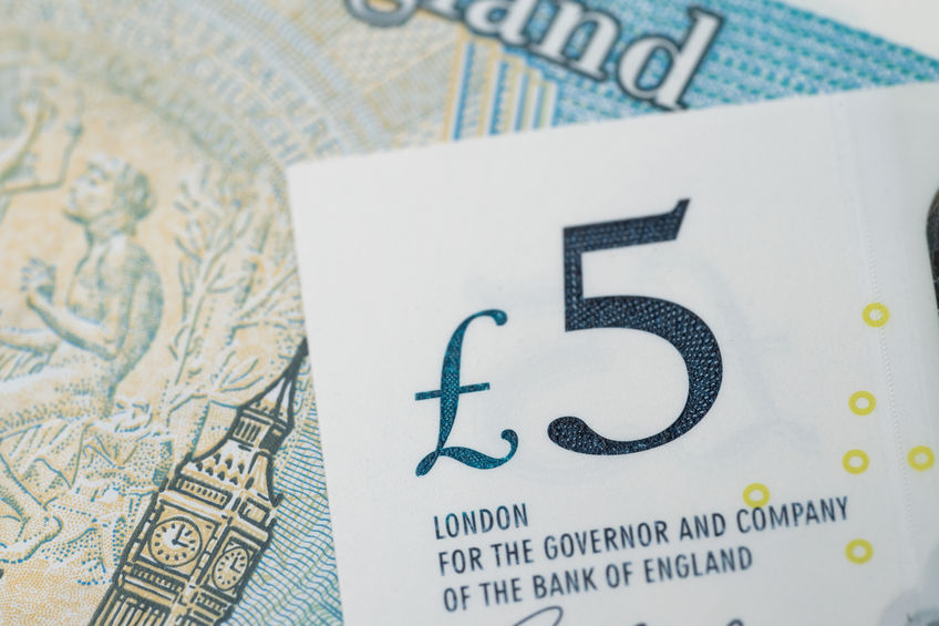 Close-up of 5 pound sterling England currency banknotes